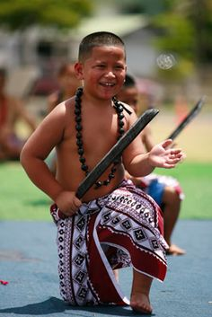 Tyson Mitania performed a knife dance with his Sunday School classmates during Samoan Heritage Week. photo by Cindy Ellen Russell@StarAdvertiser.com