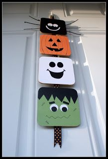 Halloween Door Hanger  Uses cork coasters, paper, vinyl and riboon. So cute.