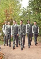 Cream colored suits, white button down shirts paired with sage green ties and pocket squares with green hypericum berry boutonnieres. Wedding style: chic, garden; Wedding colors: green, brown and white. Photo by John Robert Woods , check out more here.