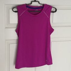 Magenta Champion Workout Tank Brand new! Never been worn before! In addition there is no sign of damage or pillage. Slim fighting and made from quick dry material allowing you to not get cold during your workouts. Champion Tops Muscle Tees
