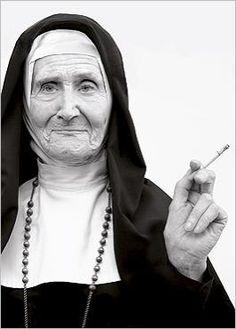 Dear God, I know you like me as I am... Wrinkled nun smoking cigarette Norbert SCHAEFERT