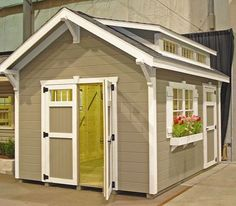 Garden shed trim, door, and flower box. Cute. #shedplans