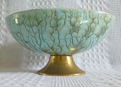 The most beautiful vintage art pottery in tree vein like pattern, robin's egg blue with brass base.