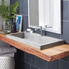 Badezimmer / Gäste WC/ I love the mix of modern and rustic in this bathroom design. This Trough 3619 Bathroom Sink is by Native Trails and looks killer upon that live edge top. Stone Bathroom Sink, Drop In Bathroom Sinks, Master Bathroom, Stone Sink, Concrete Bathroom, Modern Bathroom Sink, Bathroom Vanities, Bathroom Sink Countertop, Bathroom Cabinets