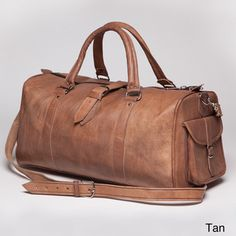 This hand-crafted leather duffle bag from Morocco is perfect for anyone on the go. Being hand made by Moroccan artisans, the slight variation in color creates a unique eye catching style. The real lea