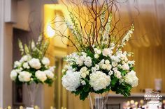 Beautiful Blooms - Tall White & Green Centerpiece with Hydrangea, Larkspur, & Curly Willow Branches