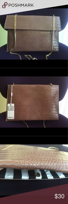 Urban Expressions Large Faux Leather Clutch Urban Expressions Large Faux Leather Clutch, brand new. Detachable chain strap. Foldover front flap with magnetic closure. Back outer pocket also magnetic closure. Great as a workbag too! Chocolate milk brown color. Urban Expressions Bags Clutches & Wristlets