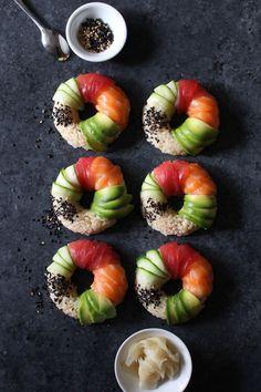 sushi doughnuts with salmon tuna avocado cucumber and toasted sesame