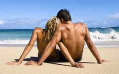 back of couple on beach