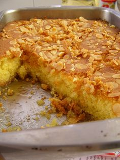 Cake ingredients: 1/2 a cup of corn oil 1/2 a cup of rose water 1/4 cup of peeled split almonds 1/2 a tsp of baking powder 1/2 a tsp of vanilla powder 2 cups of semolina 1 cup of sugar 1 cup of yog…