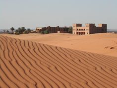 Kanz Erremal in Southern Morocco: a kasbah-hotel offering camel and jeep excursions into the spectacular Erg Chebbi dunes. http://www.i-escape.com/kanz-erremal/overview