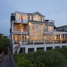 Love all of the windows and porches!