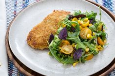 Chicken Milanese with Summer Corn, Tomato & Cucumber Salad. Visit https://www.blueapron.com/ to receive the ingredients.