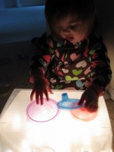 Easy DIY Light Box - clear plastic storage container, white christmas lights, wax paper, and tape - why didn't I think of that?