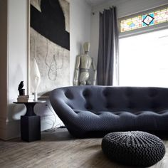 Check this out: 10 Modern Living Rooms with Nap-Worthy Sofas. https://re.dwnld.me/hXGN-10-modern-living-rooms-with-nap-worthy-sofas