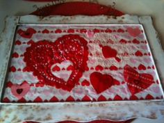 made from a metal frame with mesh from goodwill and modge pod tissue paper and valentines decorations