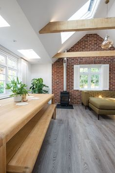This beautiful refurbishment from Aesir Construction opened three dark rooms into one airy welcoming living space Featuring six VELUX windows from Sterlingbuild exposed b. Timber Beams, Exposed Beams, Brick Feature Wall, Feature Walls, Kitchen Benches, Rustic Kitchen, Built In Wine Rack, Roof Beam, Garage Roof