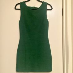 Emerald Green Bandage Dress Ribbed emerald green bandage dress from Forever 21.  Very flattering thanks to the texture of the dress.  It looks very expensive on.  Hugs the body perfectly. Forever 21 Dresses Mini