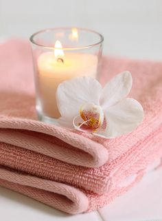 Pink towels with candle and orchid