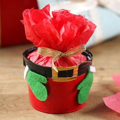 Chances are you've got some red solo cups in your pantry. Put them to good use and create these adorable St. Nick food gift containers.