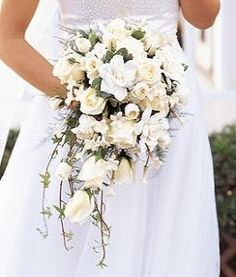 Bridal bouquet. Gardenia, white and light blue or light pink roses, etc. cascading.