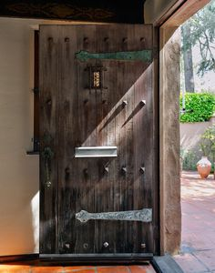 A massive door exudes patina and character. A Creative Couple's Southern California Dream Home