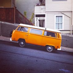 san francisco orange vw bus hill tension slipping away...