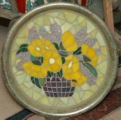 Yellow Poppies -- done from an old print on a planter saucer, using stained glass, beads and glass mosaic tiles.