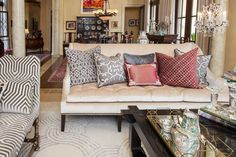 Custom Daybed, Sofa, and pillows curated by Melanie King Designs to highlight the fine furniture details desired to add luxury to this space.  Geometric cut velvets, brocades, and silks play on the many textures seen in the space. The formal living room's coffee table holds a few of the Rose Medallion porcelain pieces Lori Johnson and her mother have both collected over the years.
