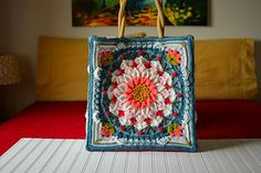 The Enchanted Garden Tote on Ravelry.  Not a free pattern, but so beautiful.   Its totally worth the $3!