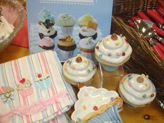 Cupcakes make great teacher gifts: Cookbook $16.99, dish towel $8.00,  covered box $5.00, dish $4.00