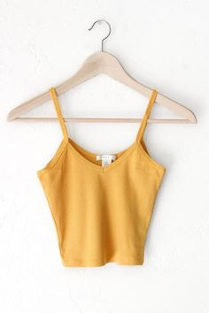 "- Description Details: Knit ribbed cami crop top in mustard yellow featuring a v-neckline. Form-fitting, tend to run on the smaller side & are more fitted. Measurements: (Size Guide) S: 24"" bust, 15"""