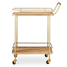 Get ready for your next big gathering with the Metal, Wood and Leather Bar Cart from Threshold™. Store your items on the sleek shelves while not in use or wheel the cart around the room on the convenient casters to serve your guests their drinks to order. This is the perfect size for navigating between rooms so every guest is taken care of.