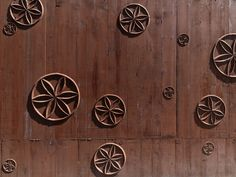 Atelier Bardill, Scharans, Switzerland, 2007 - Valerio Olgiati.  You can see the texture from the timber shuttering in the concrete.  And it looks like the joiner had to carve the wheel motif into the shuttering!