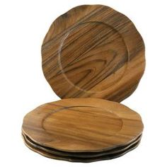 """Set of four eco-friendly hand-carved acacia charger plates.     Product: Set of 4 charger plates    Construction Material: Acacia wood    Color: Natural      Features: Eco-friendly  Food safe        Dimensions: 13"""" Diameter       Cleaning and Care: Handwash only"""