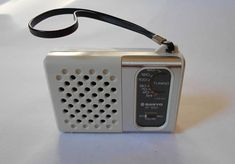 Vintage White Sanyo RP 1250 Transistor Radio in great working condition. No Chips or Cracks, Nice strap attached. Nice addition to your collection! 60s Toys, Tvs, Pocket Radio, Radios, Receptor, Transistor Radio, Wine Tasting, It Works, Vintage Items