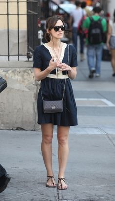 Keira Knightley in a casual dress and sandals.