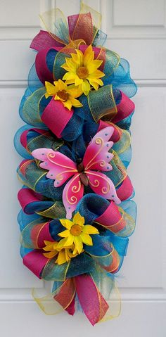 (I'm sure I could make this.) Spring/ Summer Turquoise Butterfly Mesh Swag Wreath by dottiedot05, $45.00