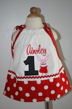 Personalized embroidered Olivia the Pig birthday pillowcase dress. $30.00, via Etsy.