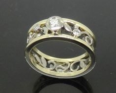 Fabulous Diamond Set White and Yellow Gold Filigree Ring with Yellow Gold Rails, custom hand made by Peter Kumskov 'My Own Jeweller Direct', Brisbane's true Bespoke high class Master Jeweller to the public  http://jewellerdirect.com.au/image/data/Gallery/Diamond%20rings/Diamond-Set-Filigree-Ring-with-Gold-Rails-web.jpg