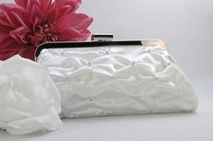 """Find the perfect purse to match your Wedding or prom gown or evening dress, and this elegant White Satin Bridal Evening Bag may be just what you're looking for, from BlissWeddingBoutique.com. This stunning pick-up style clutch in White satin, is delicately adorned with rhinestone accents and smooth clasp. Truly a stylish """"Evening"""" bag that will get you noticed by your guests."""