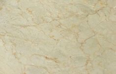 12 x 12 Crema Marfil Polished Marble tile on the Diamonte