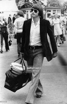 1975: American tennis player Jimmy Connors arriving with his bag and racquets at the Wimbledon Lawn Tennis Championships.