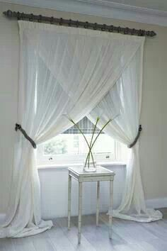 Window treatment idea. I never had thought to swing the curtains this way!