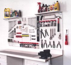 Pegboard for organizing tools in the bike room - Toby would be in heaven!