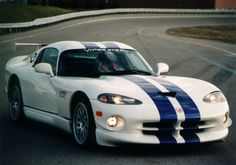 The Dodge Viper VX was unveiled at the 2012 New York Motor Show by the American car company Chrysler. The went into production in 2013 and is available as a Coupe. Check Out This Amazing Dodge Viper Video Next Page: Viper Engine and Specifications Dodge Viper, Viper Gts, Carros Chrysler, Dodge Chrysler, Us Cars, Sport Cars, Dream Cars, Car Racer, American Muscle Cars