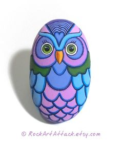 Hand Painted Owl Rock With Modern And Colorful Design! A great hand painted stone made by me!  Is painted on a smooth sea stone which i have collected from a beach on the Greek island of Ikaria. Is painted with fine art quality acrylic colors and very small brushes for the detail , is