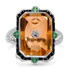 This white gold Edwardian ring showcases a rectangular shaped citrine and one single cut diamond accent. Rich colors and intricate latticewo...