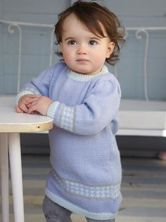 Lamb dress - Knit this baby fairisle dress from Baby 4ply Collection. Designed by Gemma Atkinson and knitted in Super Fine Merino 4ply, this dress has set in sleeves and contrast trims.