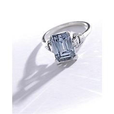 A Fine Platinum, Fancy Grayish Blue Diamond and Diamond Ring. Centering an emerald-cut Fancy Grayish Blue diamond weighing 3.02 carats, the mounting accented by baguette, single, old mine and triangle-cut diamonds weighing ~ .30 carat, circa 1930.